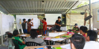 A workshop on village entrepreneurship is held at CREATE's outdoor classroom.