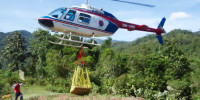 Heavy materials arrive by helicopter to villages otherwise inaccessible by car.