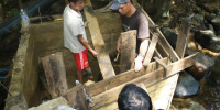 Staff, trainees, and village residents build a penstock together.